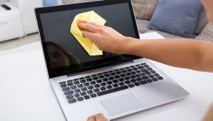 Woman Hand Cleaning Laptop Screen